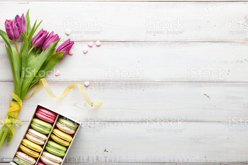 Purple tulips and a box of macarons stock photo