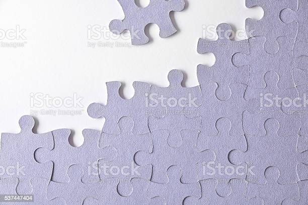Purple unfinished puzzle on a white table picture id537447404?b=1&k=6&m=537447404&s=612x612&h= wgvgikb5lhx6d qxjagt0wh8x6sm2qrslqpzolsqys=