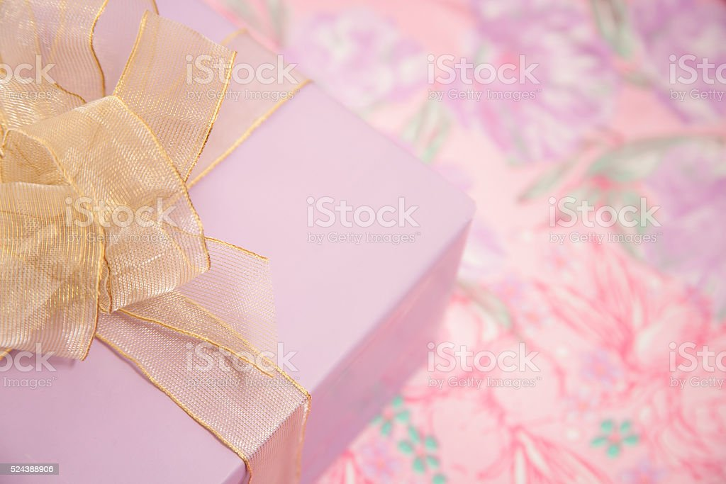 Purple wrapped birthday, Mother's Day gift. stock photo