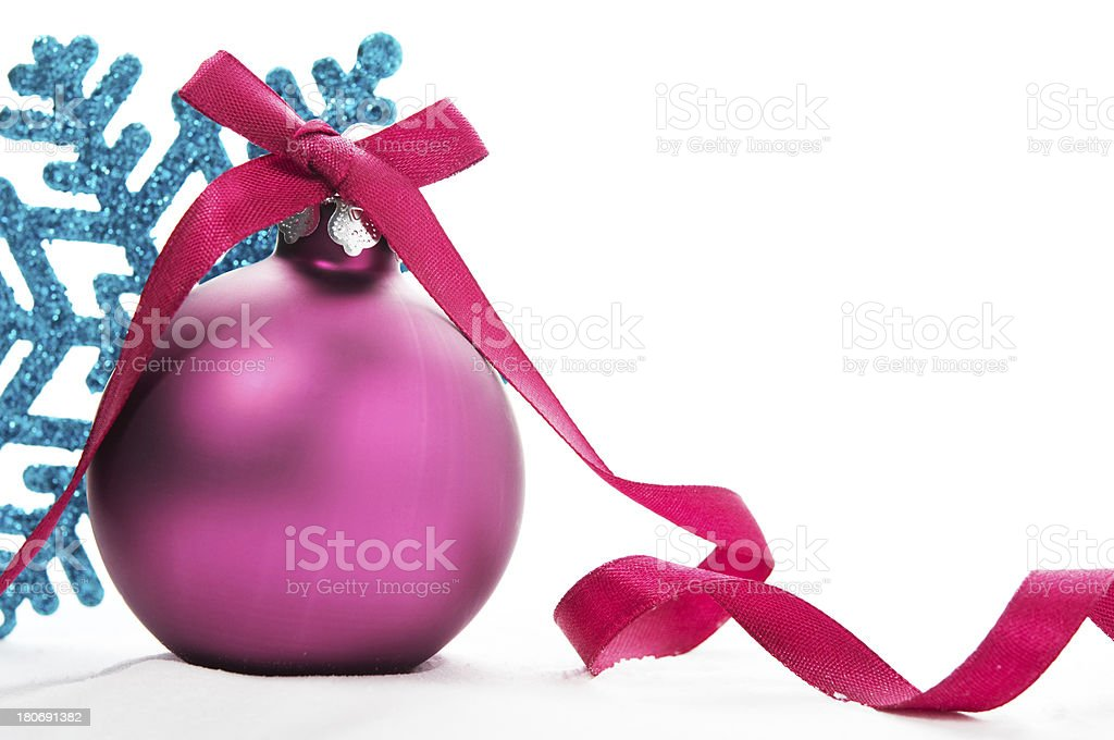 Purple xmas ball and blue snowflake royalty-free stock photo
