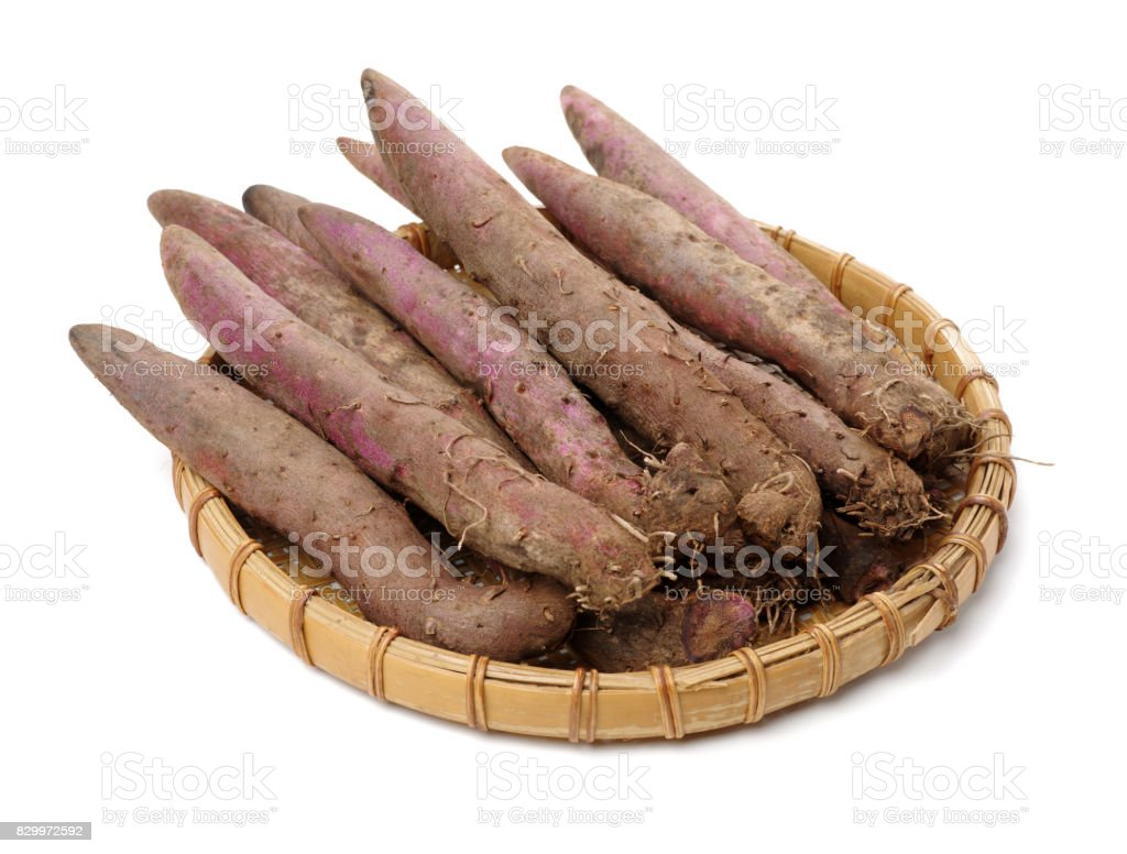 Purple yam on a white background stock photo