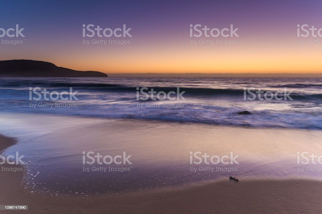 Purples and Orange - Shades of a Dawn Seascape stock photo