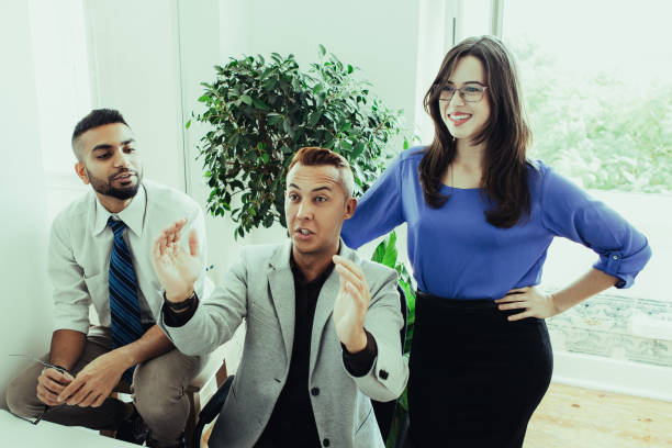 purposeful coworkers imaging new project - project manager stock photos and pictures