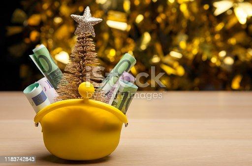 istock purse money miniature fir tree table 1183742843