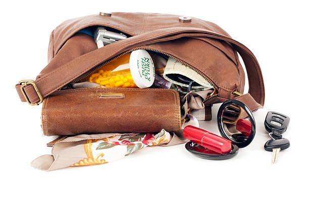 purse: open with contents spilling - handtas stockfoto's en -beelden