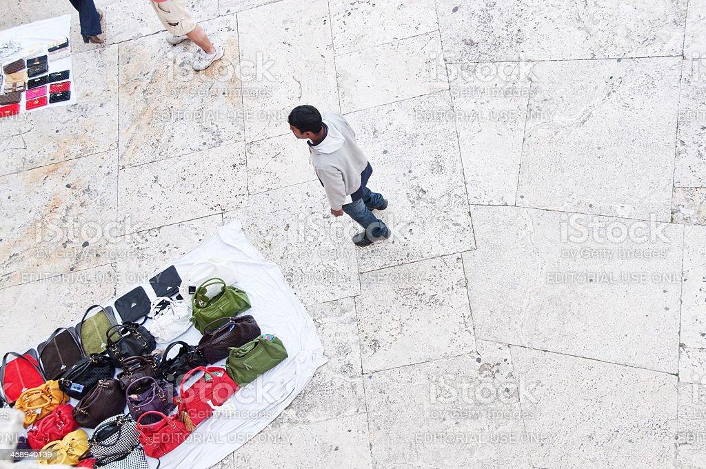 Purse Vendor in Rome royalty-free stock photo