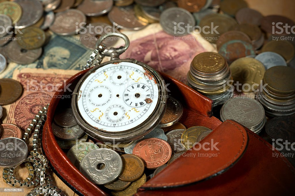 Purse with Broken Pocket Watch and Coins stock photo