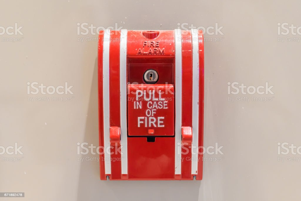 Push button switch fire alarm box on cement wall for warning and security system stock photo
