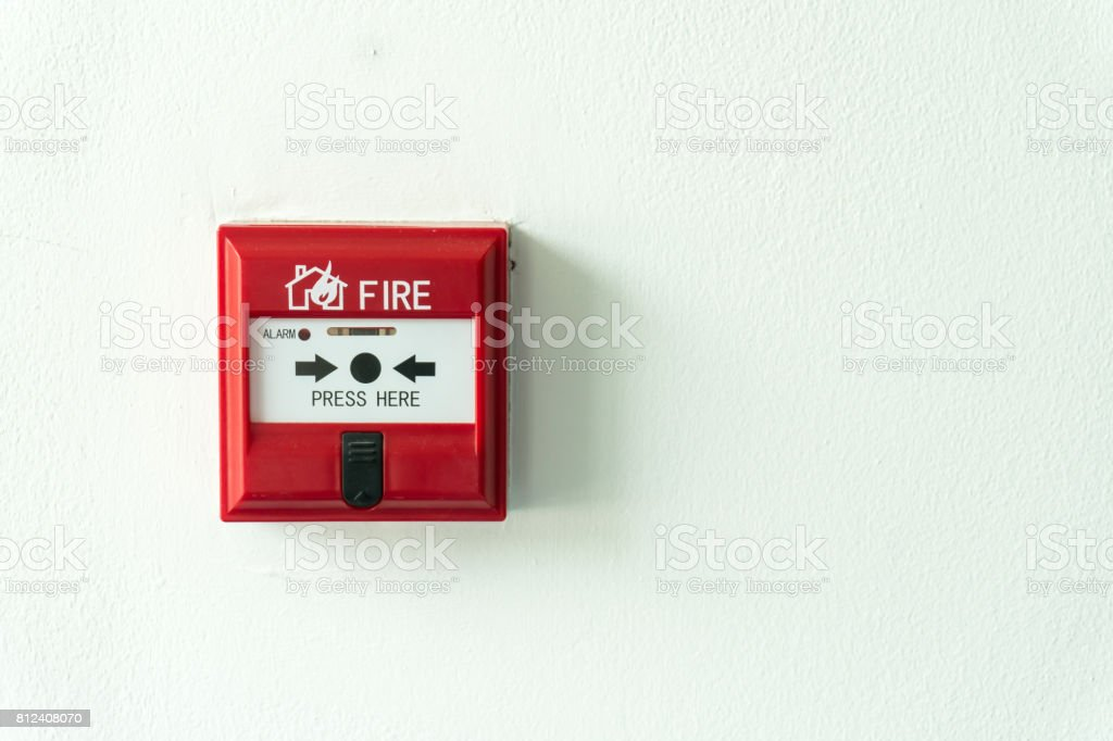 Push button switch fire alarm box on cement wall for warning and security system. Copy space background stock photo