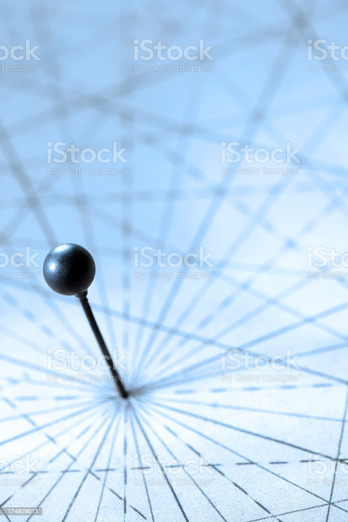 Push pin at intersection of radiating lines on map stock photo