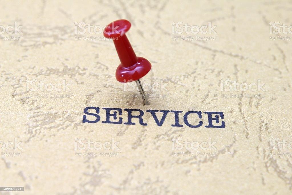 Push pin on service royalty-free stock photo
