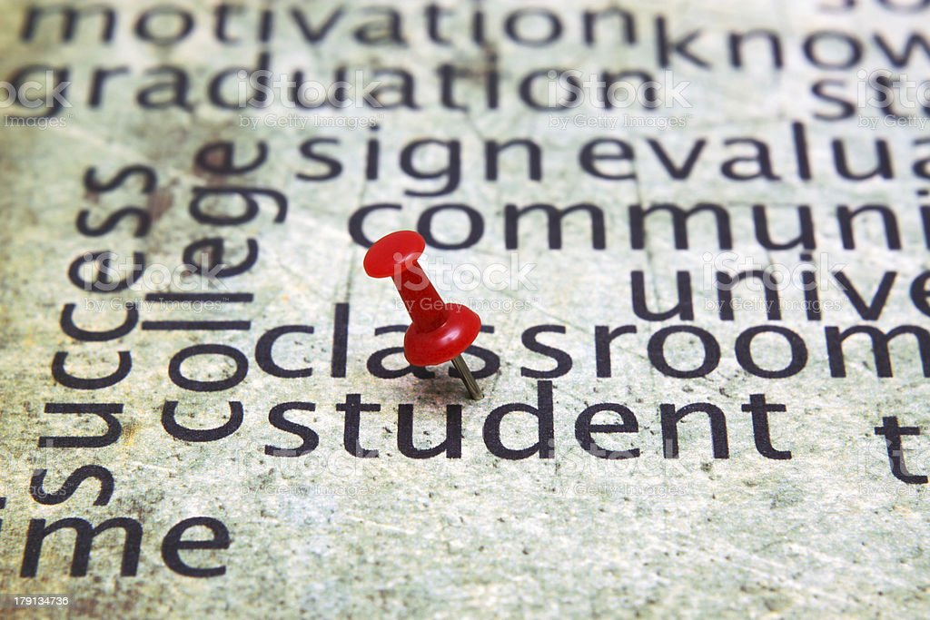 Push pin on student text royalty-free stock photo