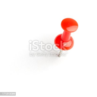Red push pin isolated on white with a soft drop shadow