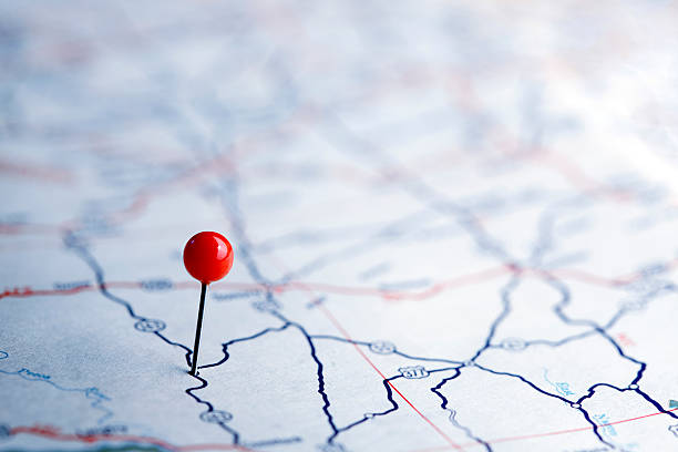 push pins on a road map - road map stock photos and pictures