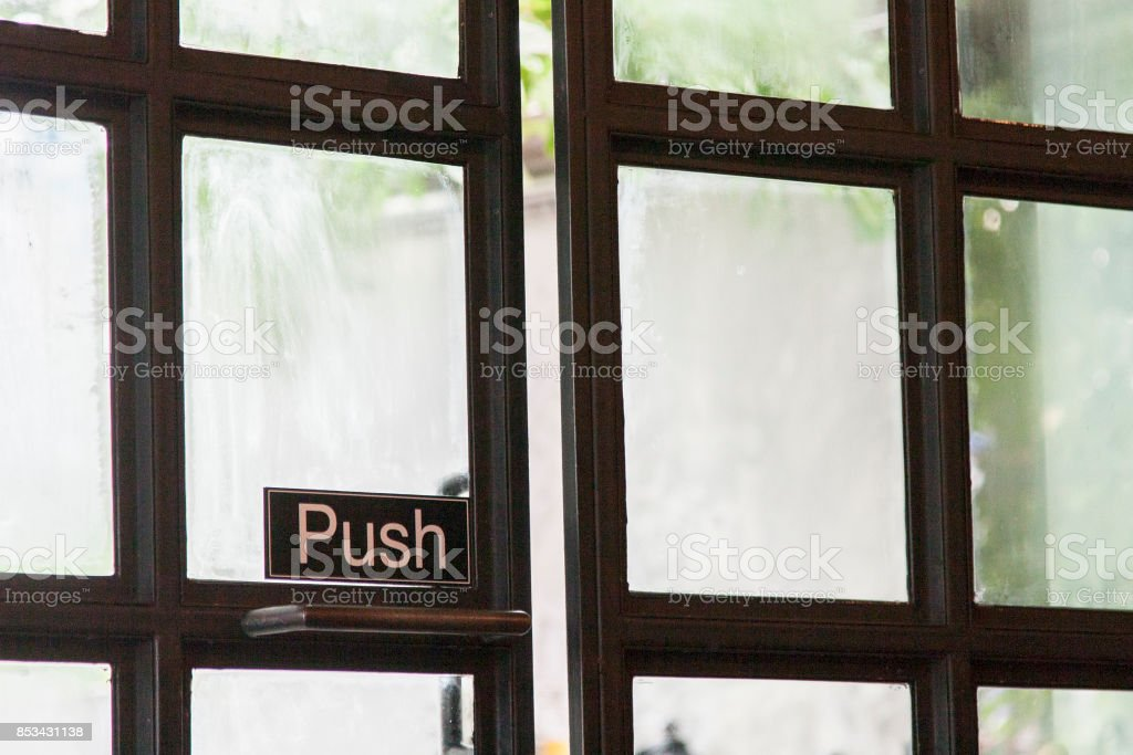 push sign on the door stock photo