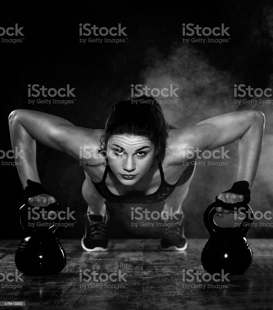 push ups with kettle bell stock photo