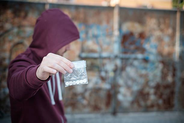 pusher selling and trafficking drug dose - amfetamin bildbanksfoton och bilder