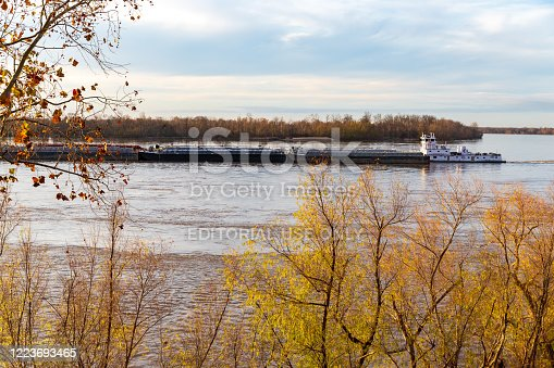Vicksburg, MS / USA - December 12, 2019: Canal Barge Pusher Towboat on the Mississippi River in Vicksburg, Mississippi
