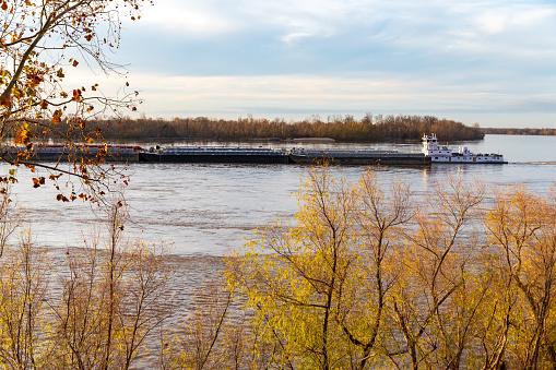 Vicksburg, MS / USA - December 12, 2019: Canal Barge Pusher Towboat on the Mississippi River in Vicksburg, Mississippi