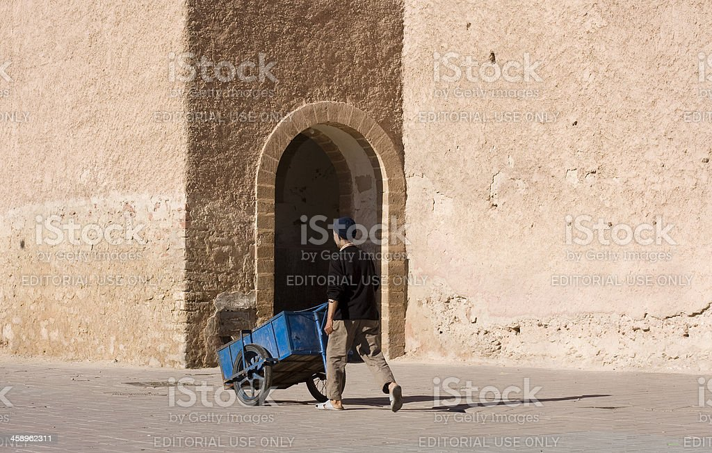 Pushing a handcart, Essaouira, Morocco royalty-free stock photo