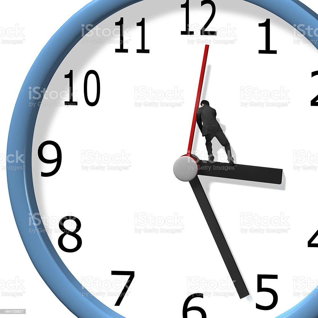 Pushing clock hand stock photo