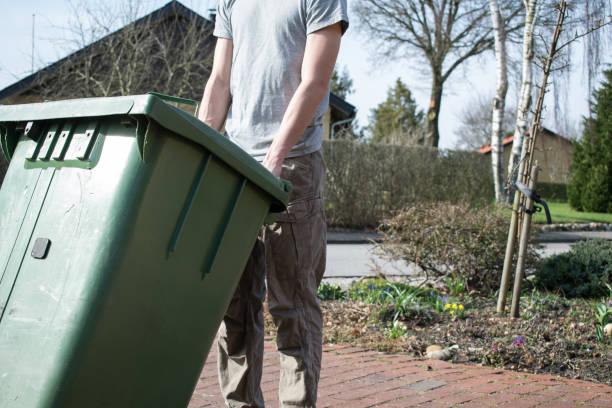 Pushing Garbage Bin stock photo