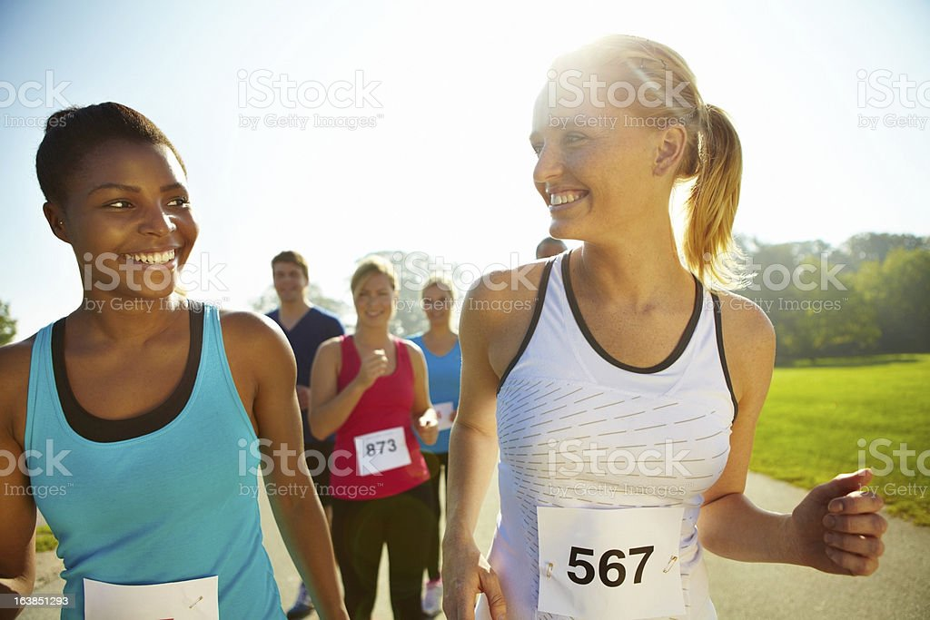 Pushing harder with the support of her peers royalty-free stock photo