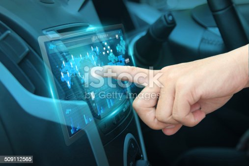 istock Pushing on car screen interface 509112565