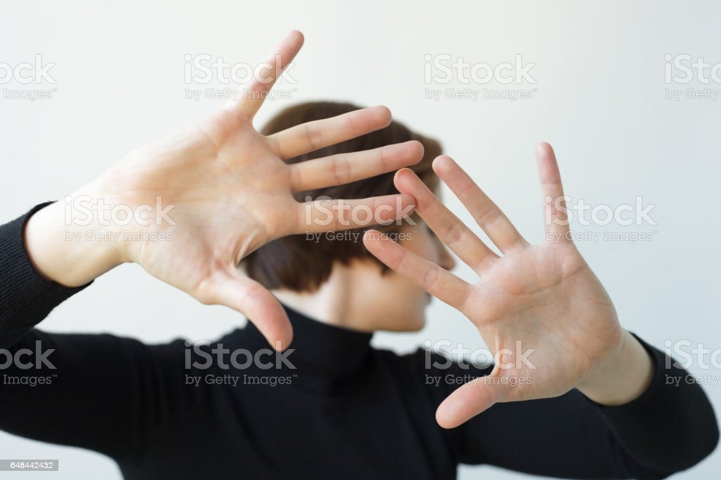 Pushing someone away from contact stock photo