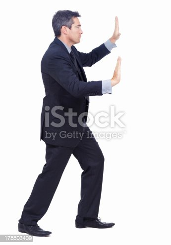Profile of a businessman pushing against an invisible wall - isolated