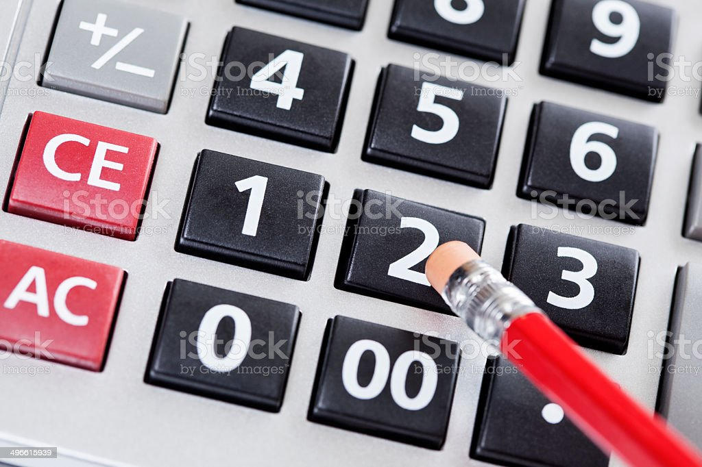 Pushing the button on a calculator royalty-free stock photo
