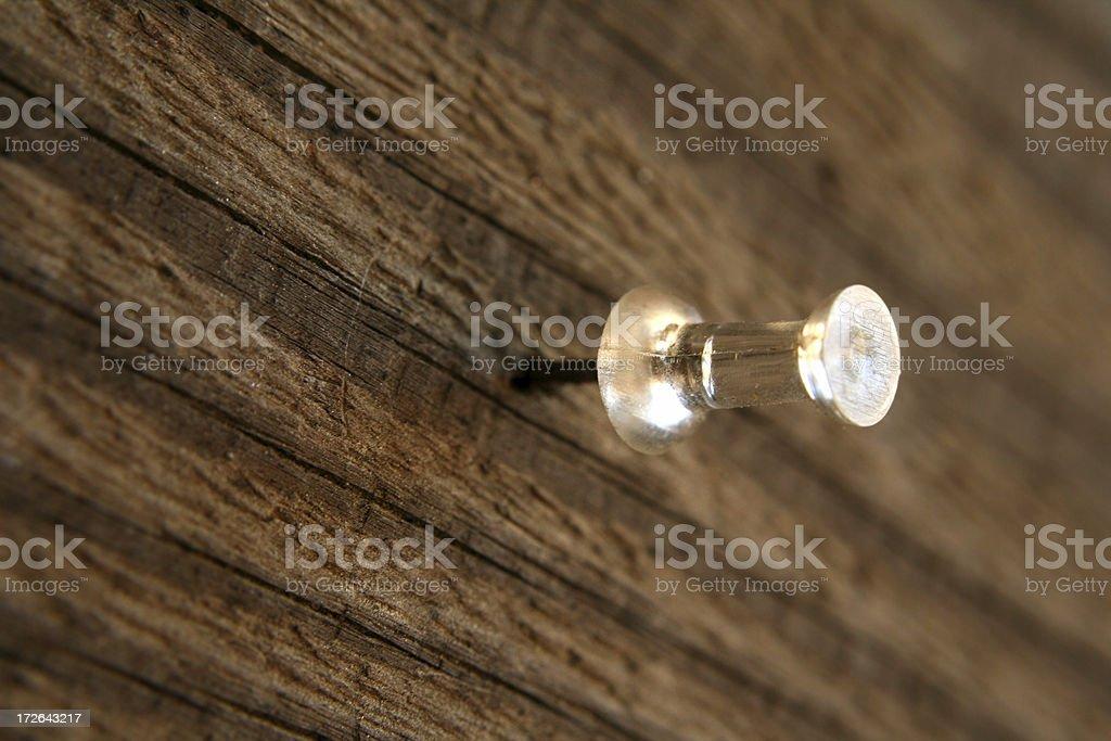 Push-pin in wood stock photo