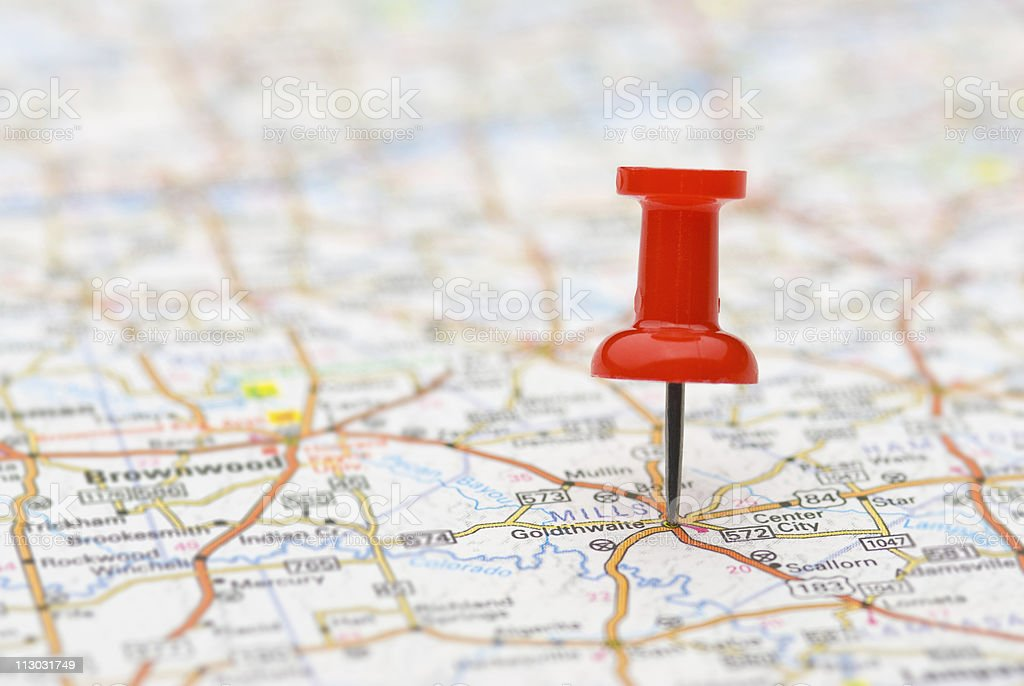 Pushpin marking location on map stock photo
