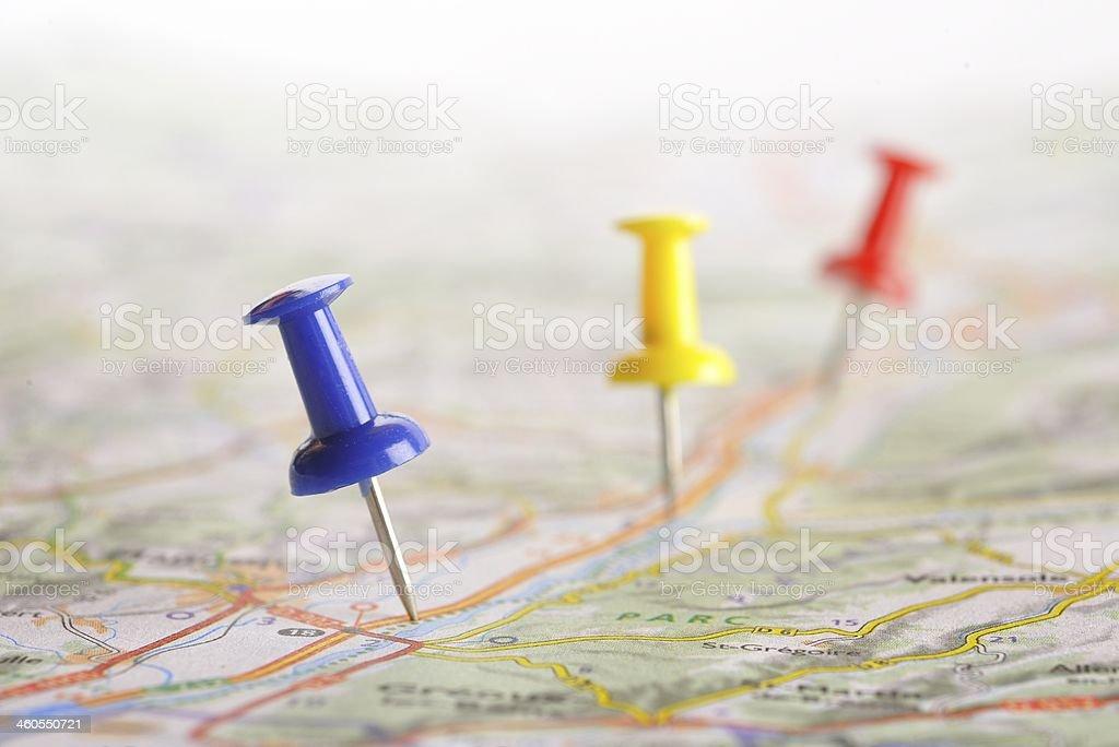 pushpin on map stock photo