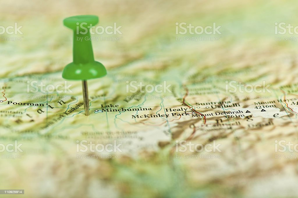 Pushpin stuck in a location on the map royalty-free stock photo