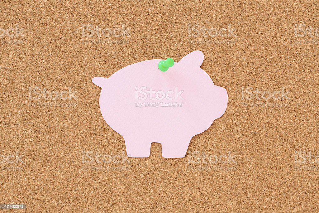 Pushpined piggy bank royalty-free stock photo