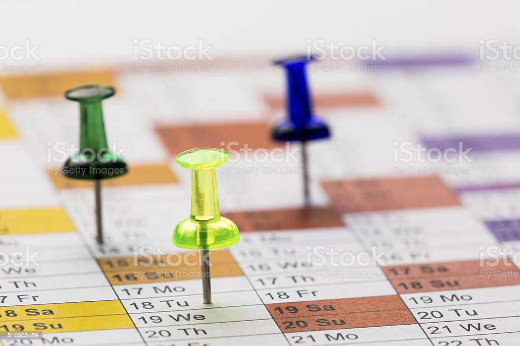 Pushpins on calendar stock photo
