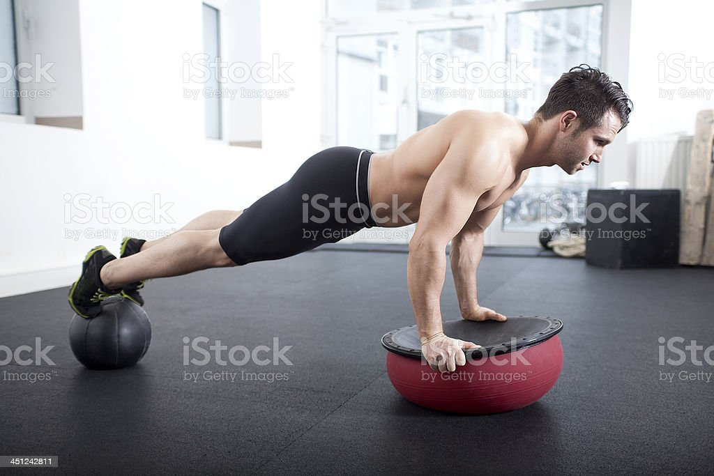 Push-up a with medicine ball for balance and core strength stock photo
