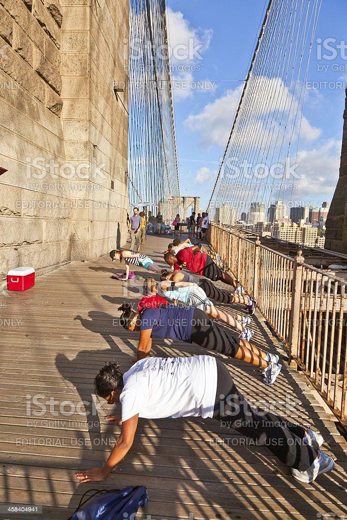 push-up at Brooklyn Bridge in New York royalty-free stock photo