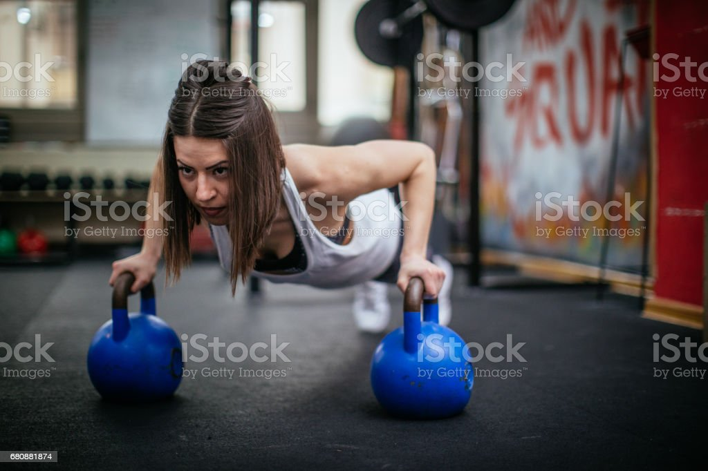 Push-up exercise in gym royalty-free stock photo