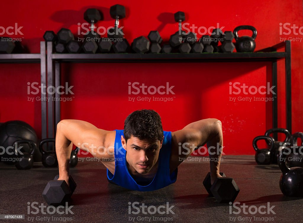 push-up strength man hex dumbbells workout at gym royalty-free stock photo