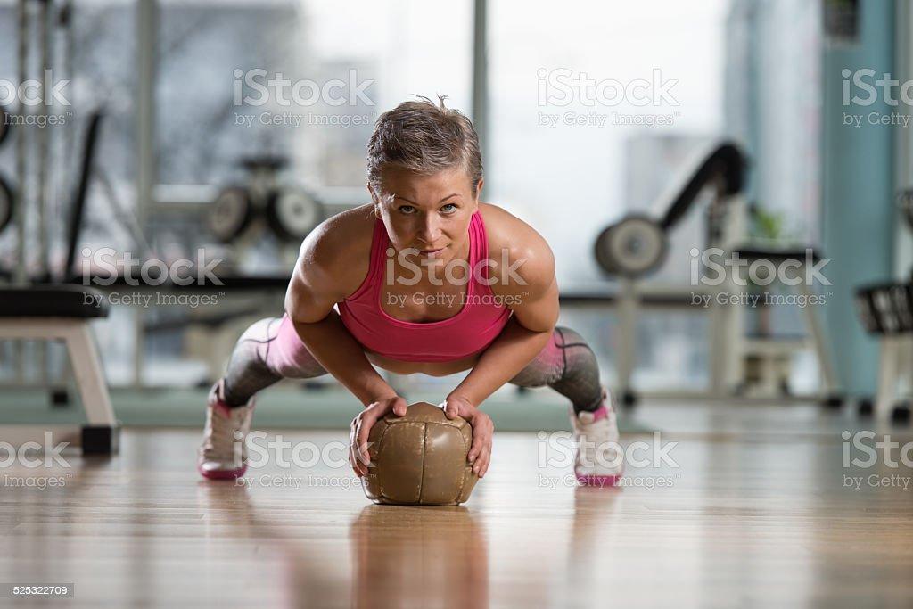Push-Ups On Medicine Ball stock photo