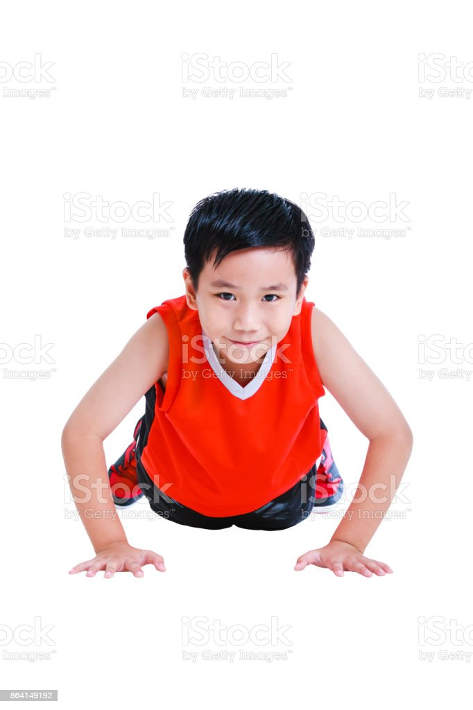Push-ups or press-ups exercise by asian child. Isolated on white background. royalty-free stock photo