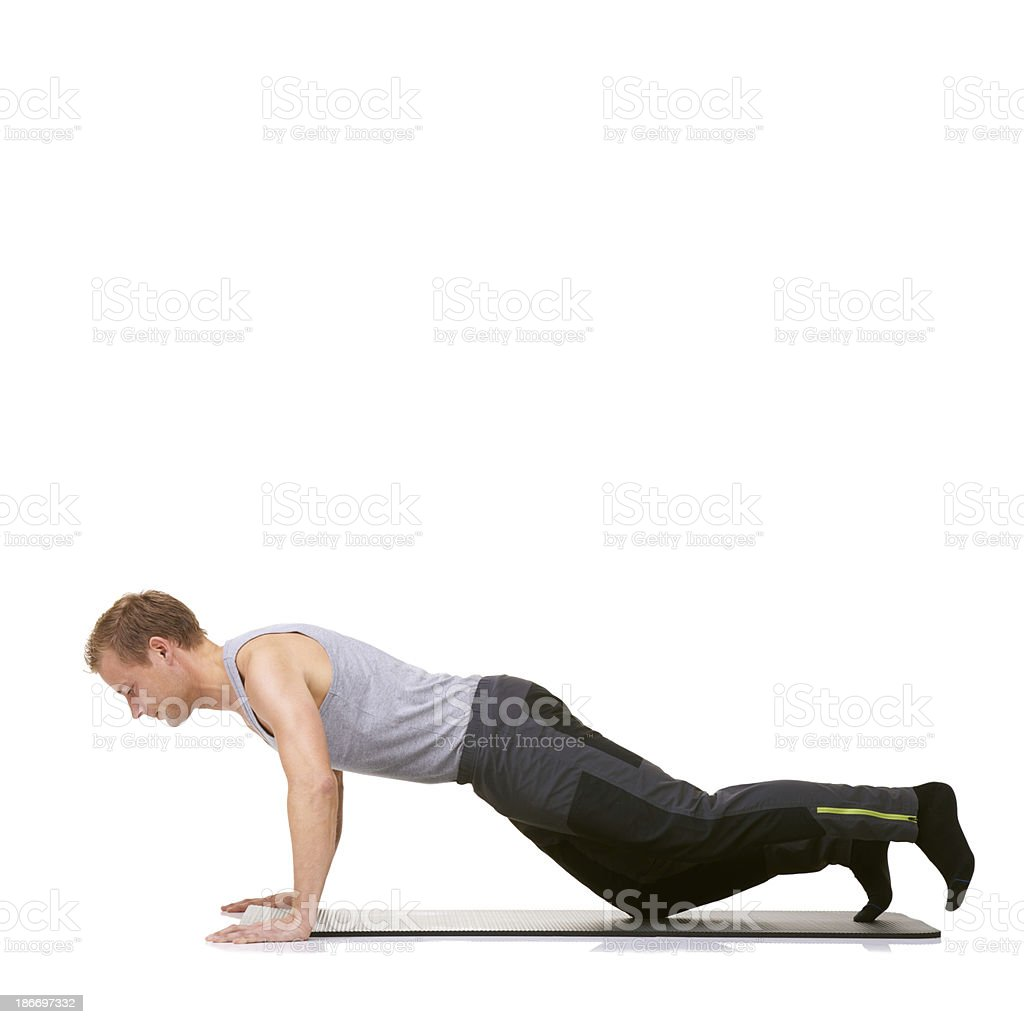Push-ups working his chest muscles royalty-free stock photo