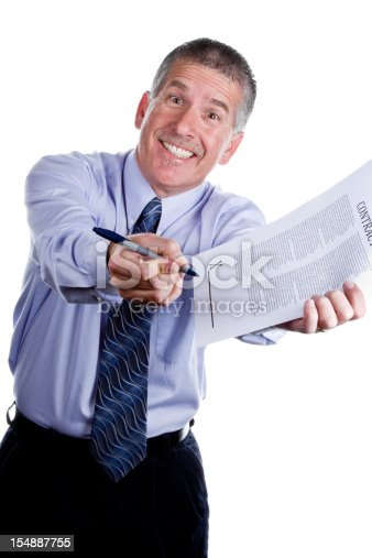 Smiling man with a cheesy grin gesturing for you to sign a contract, isolated on white. Man is mid 40s caucasian, has a mustache and short grey hair and is wearing a blue long sleeve shirt and dark blue tie. He is portraying a role as a used car salesman or some other type of high pressure sales.