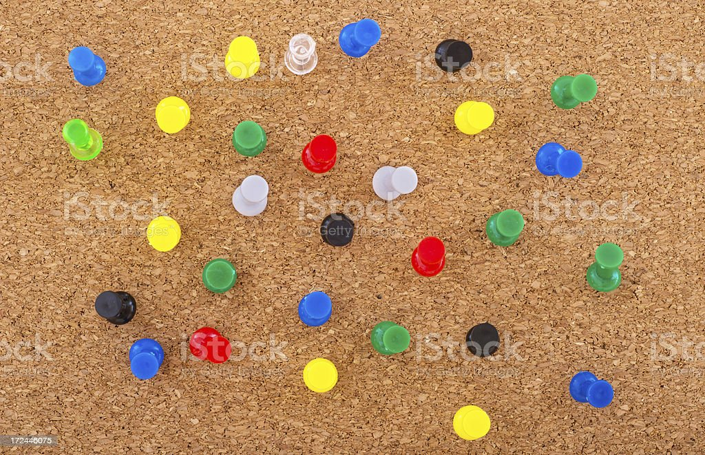 puspins on corkboard -Reiszwecken auf Korkboard stock photo