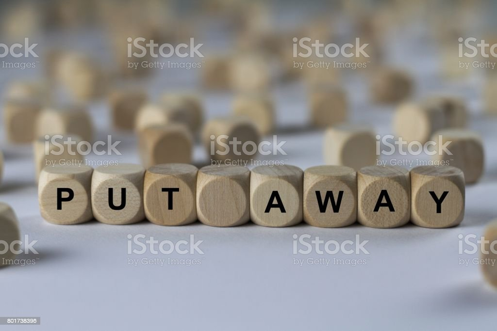put away - cube with letters, sign with wooden cubes stock photo