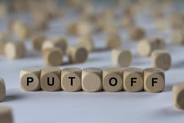 put off - cube with letters, sign with wooden cubes - disconcert stock pictures, royalty-free photos & images