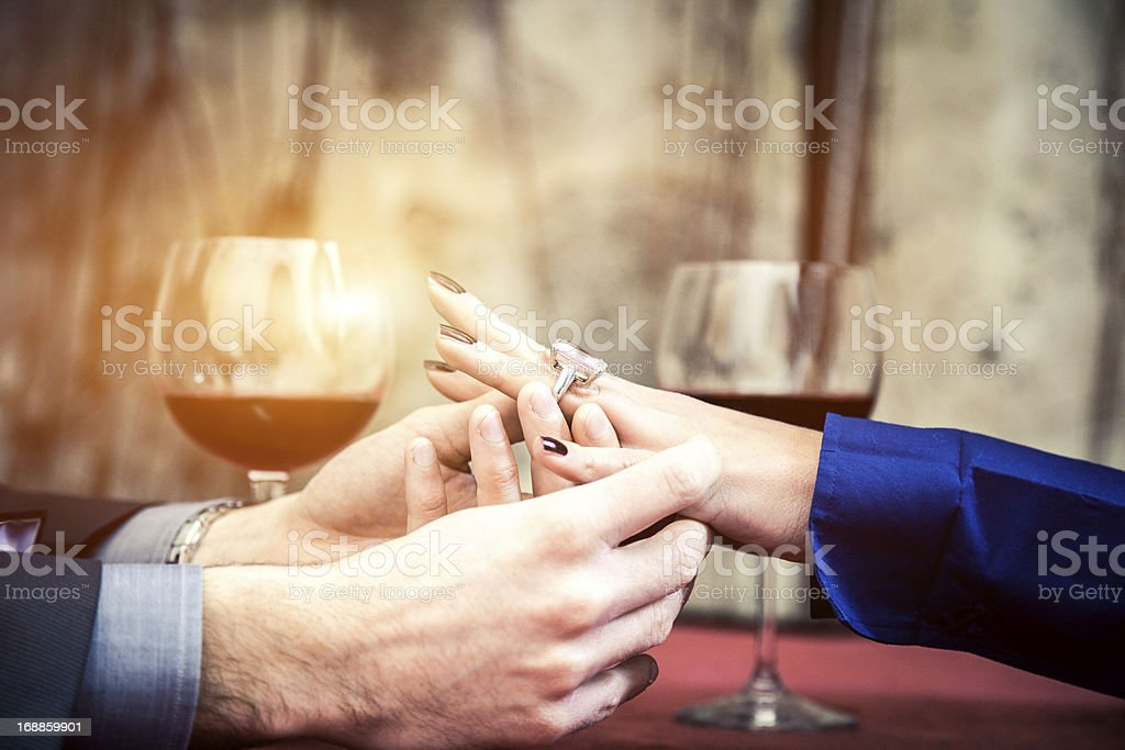 Put on ring upon a bride fingers stock photo