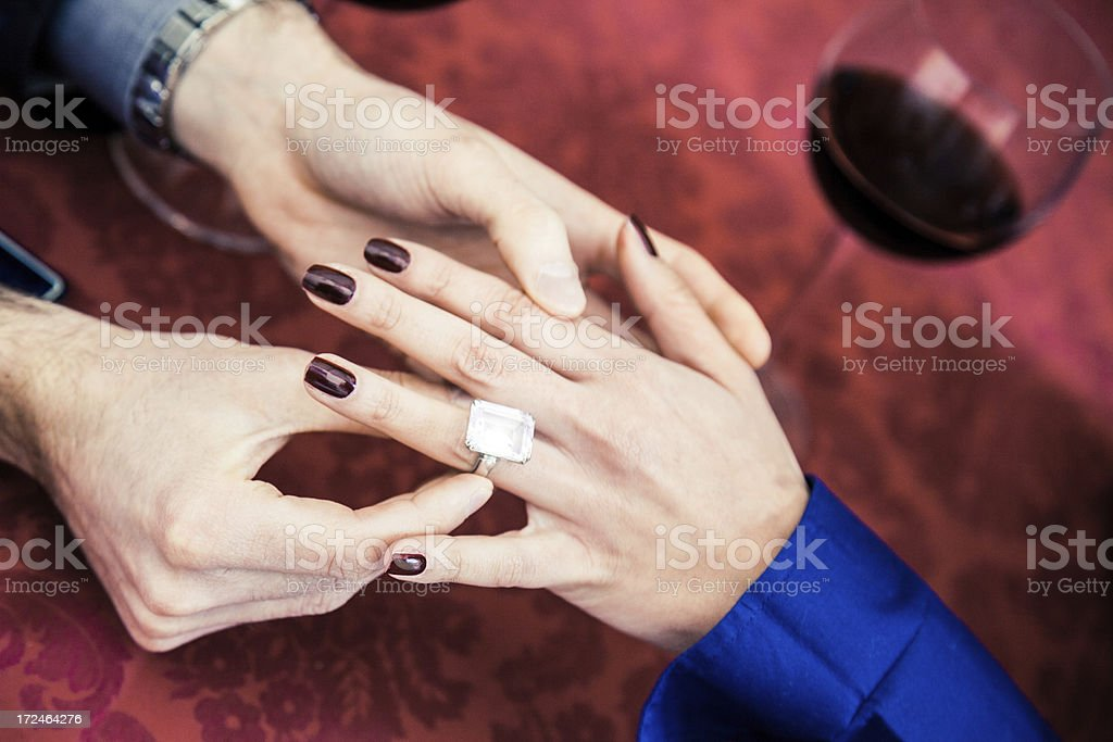 Put on ring upon a bride fingers royalty-free stock photo